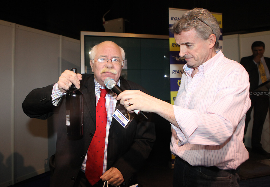 ***NO FEE PIC***.28/01/2011.Jose Ramos Director of Portugeese Tourist Office hands Ryanair CEO Michael O' Leary a bottle of wine at the Travel Clinic during the Holiday World Show in the RDS, Dublin..Photo: Gareth Chaney Collins