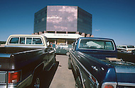 May 6th to 13th, 1985 in Navajo Reserve, AZ. Pick ups in front of a commercial center.