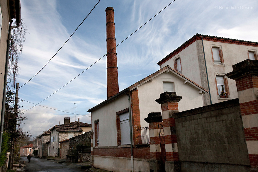 9 december 2009 - Coustilleres' hat factory, Septfonds, France -  Old abandonated hat factories in Septfonds..Septfonds is the heart of French straw hat making, due to its very ancient hatter tradition. The hat making industry had its commercial peak in the late 19th century..Coustillères is a family owned hat making factory that has been making straw hats in Septfonds for nearly 100 years. They make hats from straw, felt, and cloth as well as caps. The current owner is Jean-Claude Coustilleres. He is one of the last hat makers of the region..The straw hat making process is very labor intensive and numerous hands are involved. Nearly all of the equipment is over 100 years old, they use the original presses and tools including aluminium molds and sewing machines and dye their own straw continuing the traditional methods of manufacturing. The hat blocking and shaping, straw braids construction and dyeing are all done by hand..The company works on behalf of fashion houses and makes a variety of regional and historical hats. It produces 2 collections a year distributed by a network of salespeople and through a catalog to clients around the world. Photo credit: Benedicte Desrus