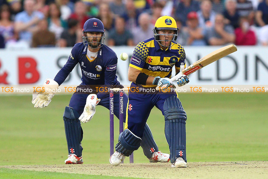 Colin Ingram of Glamorgan hits out as James Foster looks on from behind the stumps during Essex Eagles vs Glamorgan, NatWest T20 Blast Cricket at the Essex County Ground on 29th July 2016