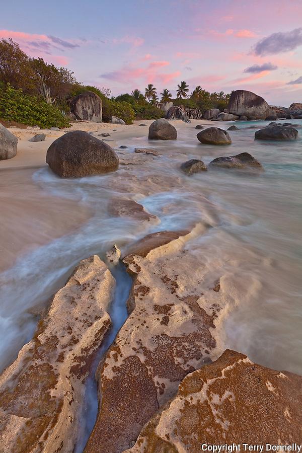 Virgin Gorda, British Virgin Islands, Caribbean<br /> Evening light on the surf and rock patterns on the beach of Little Trunk Bay near the Baths