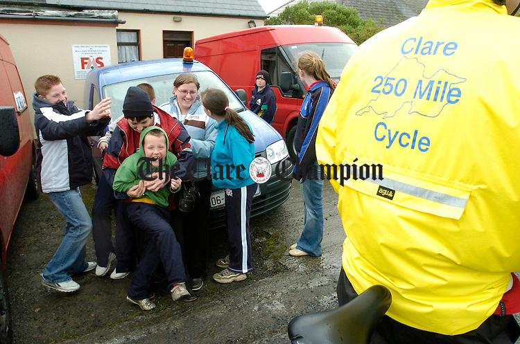 Local youngsters mess about for of the camera as the Clare 250 miles cancer cycle arrives in the village of Mullagh. Photograph John Kelly.