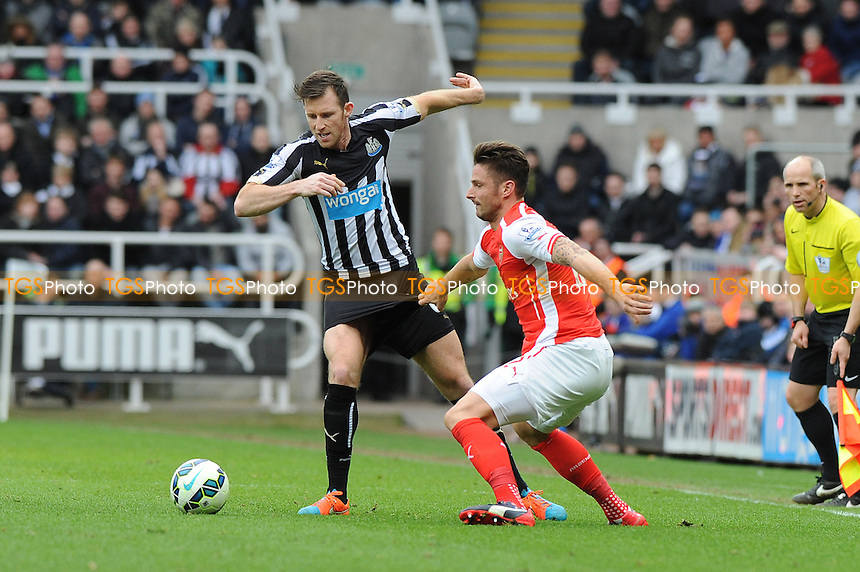 Michael Williamson of Newcastle United battles with Calum Chambers of Arsenal - Newcastle United vs Arsenal - Barclays Premier League Football at St James Park, Newcastle upon Tyne - 21/03/15 - MANDATORY CREDIT: Steven White/TGSPHOTO - Self billing applies where appropriate - contact@tgsphoto.co.uk - NO UNPAID USE