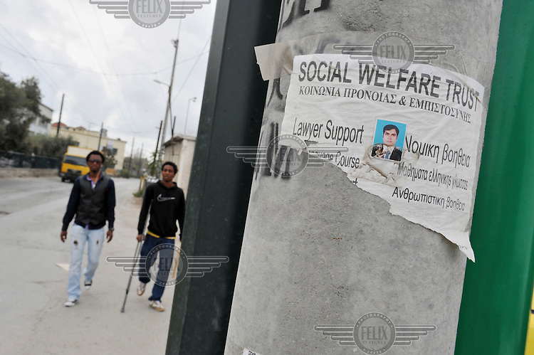 An asylum lawyer offers his services on a pole next to the Central Police Asylum Department in Athens, the place where immigrants try to get or extend their resident permits. According to UNHCR, 38,992 immigrants arrived in Greece in the first 10 months of 2010, whereas in 2009 the number was only 7,574.
