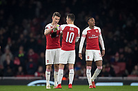 Laurent Koscielny of Arsenal hands Mesut Ozil of Arsenal the captains armband during the UEFA Europa League match between Arsenal and Qarabag FK at the Emirates Stadium, London, England on 13 December 2018. Photo by Andy Rowland.