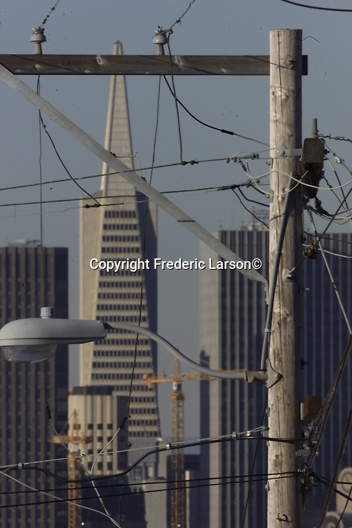 BLACKOUTS-17JAN00-MN-FRL:  Rolling blackouts affected Northern California.   Chronicle photo by Frederic LarsonA quagmire of telephone lines and power lines engulf city streets up on Potrero hill of San Francisco, California.