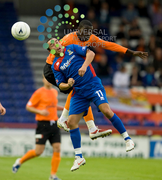 FOOTBALL.Pre season friendlie.Inverness CT vDundee Utd.Inverness player Dougie Imrie and Prince Bauben Dundee Utds  Prince Bauben aerial duel..Picture by Gordon Gillespie