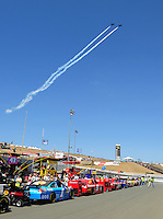 Jun. 21, 2009; Sonoma, CA, USA; Jets perform an airshow over NASCAR Sprint Cup Series cars on pit road prior to the SaveMart 350 at Infineon Raceway. Mandatory Credit: Mark J. Rebilas-
