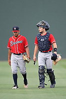 Catcher Shea Langeliers (4), right, the Atlanta Braves' top pick in the 2019 MLB Draft, now with the Rome Braves, walks in from the bullpen with starting pitcher Dilmer Mejia (51) on Thursday, June 27, 2019, at Fluor Field at the West End in Greenville, South Carolina. Rome won, 4-3. (Tom Priddy/Four Seam Images)