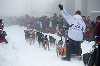 Fans watch aron Burmeister and team run down Cordova Street in the fog during the ceremonial start of the Iditarod sled dog race Anchorage Saturday, March 2, 2013. ..Photo (C) Jeff Schultz/IditarodPhotos.com  Do not reproduce without permission