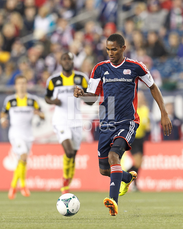 New England Revolution forward Jerry Bengtson (27) passes the ball.  In a Major League Soccer (MLS) match, the New England Revolution (blue) defeated Columbus Crew (white), 3-2, at Gillette Stadium on October 19, 2013.