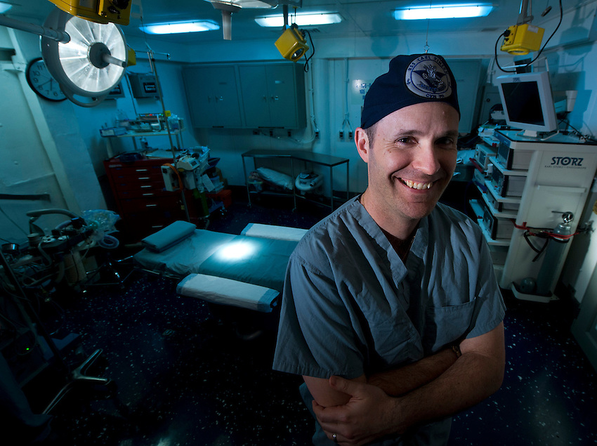 120510-N-DR144-022 .PACIFIC OCEAN (May 10, 2012) Ship's Surgeon Lt. Cmdr. Matthew Tadlock is pictured in the operating room aboard the Nimitz-class aircraft carrier USS Carl Vinson (CVN 70). Vinson's surgical team has performed 148 general surgeries, including 36 urgent emergency procedures, and 180 oral surgeries for Sailors assigned to Carl Vinson and Carrier Strike Group 1 since the ship deployed Nov. 30, 2011. Carl Vinson and Carrier Air Wing (CVW) 17 are deployed to the U.S. 7th Fleet area of operations. (U.S. Navy photo by Mass Communication Specialist 2nd Class James R. Evans/Released).