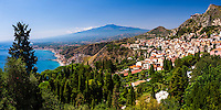 Taormina, panoramic photo of Mount Etna Volcano and Taormina seen from Teatro Greco aka Greek Theatre or Amphitheatre, Sicily, Italy, Europe. This is a panoramic photo of Mount Etna Volcano and Taormina seen from Teatro Greco aka Greek Theatre or Amphitheatre, Sicily, Italy, Europe.