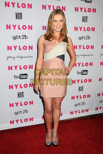 SARA CANNING .Nylon Magazine's Young Hollywood Party held at the Roosevelt Hotel's Tropicana Bar, Hollywood, California, USA..May 12th, 2010.full length pink beige white black dress grey gray hand on hip .CAP/ADM/BP.©Byron Purvis/AdMedia/Capital Pictures.