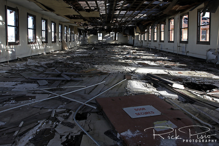 Light filters through the roof of an abandoned barracks at the closed Mare Island Naval Shipyard near Vallejo, California.