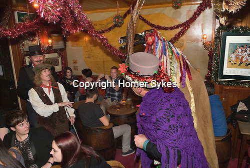Sandgate Hoodeners. The Hooden Horse at the Ship Inn at Sandgate, Kent, UK<br /> <br /> Wagoner, The Boy, Mollie.<br /> <br /> Mollie or Molly,woman played by a man past her prime.