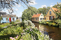 Nederland Westzaan. 2016. Houten huizen in Westzaan. Foto Berlinda van Dam / Hollandse Hoogte