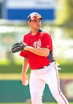 22 February 2013: Washington Nationals' third baseman Ryan Zimmerman fields infield grounders during a full squad Spring Training workout at Space Coast Stadium in Viera, Florida. Mandatory Credit: Ed Wolfstein Photo *** RAW File Available ***