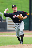 Third baseman Jake Oester #22 of the Kannapolis Intimidators makes a throw to first base against the Hickory Crawdads at  L.P. Frans Stadium August 1, 2010, in Hickory, North Carolina.  Photo by Brian Westerholt / Four Seam Images