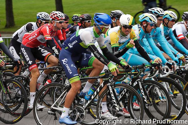 Simon Gerrans from Australia chats to teammate Christian Meier of Canada for team Orica during the Montreal Grand Prix Cycliste event