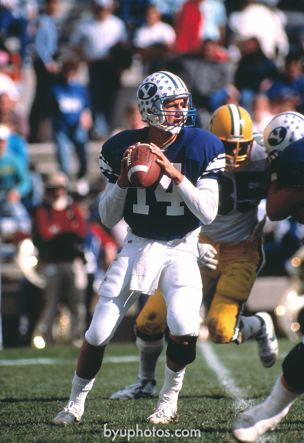 Ty Detmer drops back for a pass against University of Oregon.  .Nov. 1989..Photo by Mark Philbrick/BYU