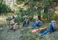 Outdoor Life Editor Andrew McKean, Mike Stock, and guide Greg Kriese and Tim Trefren with Trefren Outfitters take target practice and calibrate their guns before hunting on Greyback Ridge in the Hoeback Drainage of Wyoming Region H, outside of Alpine, Wyoming, September 20, 2015.<br /> <br /> Photo by Matt Nager
