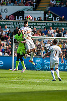 Jordi Amat of Swansea City  jumps for the ball during the Barclays Premier League match between Swansea City and Manchester City played at the Liberty Stadium, Swansea on the 15th of May  2016