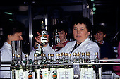 Krakow, Poland. Polmos Vodka factory; women workers with Zubrowka Vodka bottles.