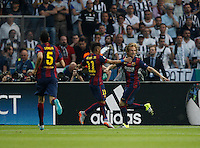 Calcio, finale di Champions League Juventus vs Barcellona all'Olympiastadion di Berlino, 6 giugno 2015.<br /> FC Barcelona's Ivan Rakitic, right, celebrates with teammates Sergio Busquets, left, and Neymar, after scoring during the Champions League football final between Juventus Turin and FC Barcelona, at Berlin's Olympiastadion, 6 June 2015.<br /> UPDATE IMAGES PRESS/Isabella Bonotto