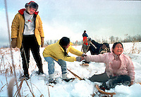 On a school field trip, twins Khoua and Choua Yang try out snowshoeing for the first time.