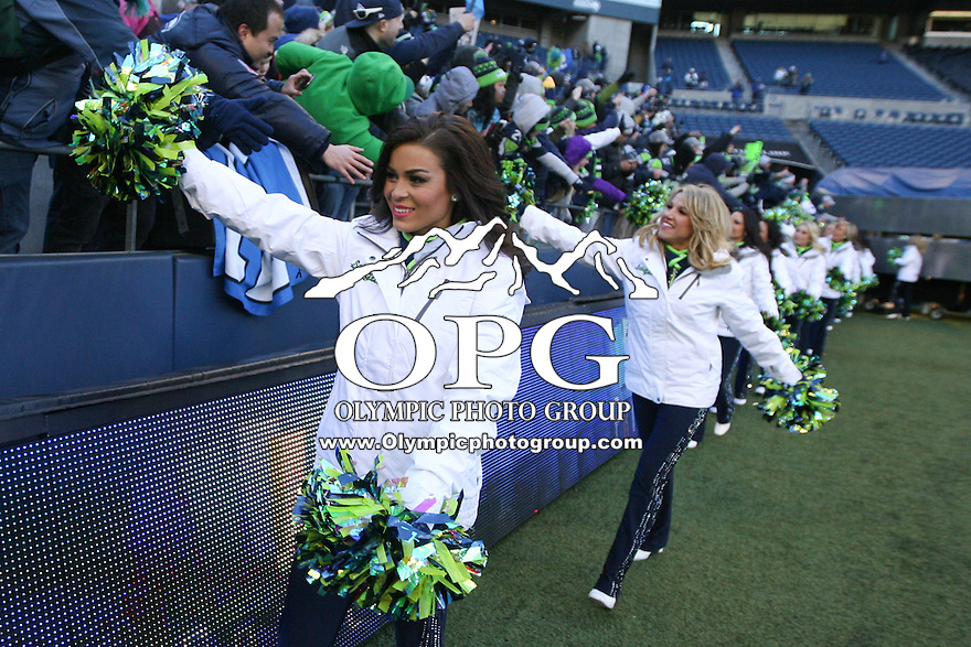 2014-02-05:  Seattle Sea Gals entertained fans at the start of the 12th Man kickoff celebration.  Seattle Seahawks players and 12th man fans celebrated bringing the Lombardi trophy home to Seattle during the Super Bowl Parade at Century Link Field in Seattle, WA.