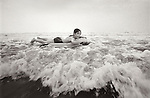 1978. Brigantine beach, NJ. Kirsten riding on float in the surf.