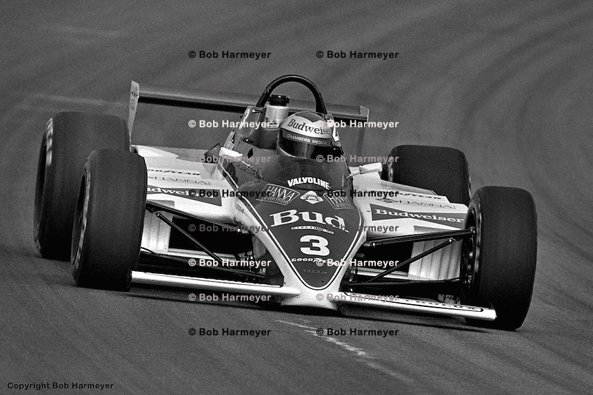 INDIANAPOLIS, IN - MAY 29: Mario Andretti drives his Lola T700 HU02/Cosworth during practice for the Indianapolis 500 on May 29, 1983, at the Indianapolis Motor Speedway in Indianapolis, Indiana.