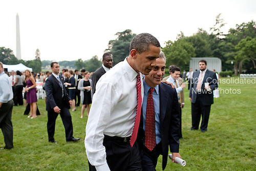 Washington, DC - June 26, 2009 -- United States President Barack Obama speaks with White House Chief of Staff Rahm Emanuel during the White House staff picnic on the South Lawn of the White House, June 26, 2009..Mandatory Credit: Pete Souza - White House via CNP