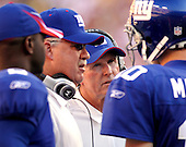 Landover, MD - September 23, 2007 -- New York Giants head coach Tom Coughlin talks strategy with his quarterback, Eli Manning (10), in late second quarter action against the Washington Redskins at FedEx Field in Landover, MD on Sunday, September 23, 2007..Credit: Ron Sachs / CNP.(RESTRICTION: NO New York or New Jersey Newspapers or newspapers within a 75 mile radius of New York City)