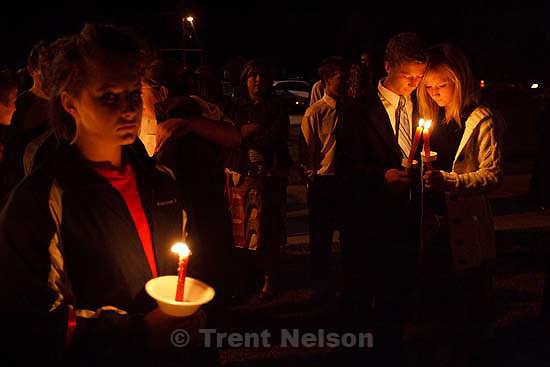 American Fork High School students Cree Anderson (left) and Cassedy Christensen hold candles during a vigil that followed a memorial service at American Fork High School Sunday, October 11 2009 to pay tribute to teacher Heather Christensen, who died in a bus crash after attempting to gain control of the bus.