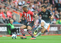 Southampton's Mario Lemina under pressure from Burnley's Jack Cork<br /> <br /> Photographer Kevin Barnes/CameraSport<br /> <br /> The Premier League - Southampton v Burnley - Sunday August 12th 2018 - St Mary's Stadium - Southampton<br /> <br /> World Copyright &copy; 2018 CameraSport. All rights reserved. 43 Linden Ave. Countesthorpe. Leicester. England. LE8 5PG - Tel: +44 (0) 116 277 4147 - admin@camerasport.com - www.camerasport.com