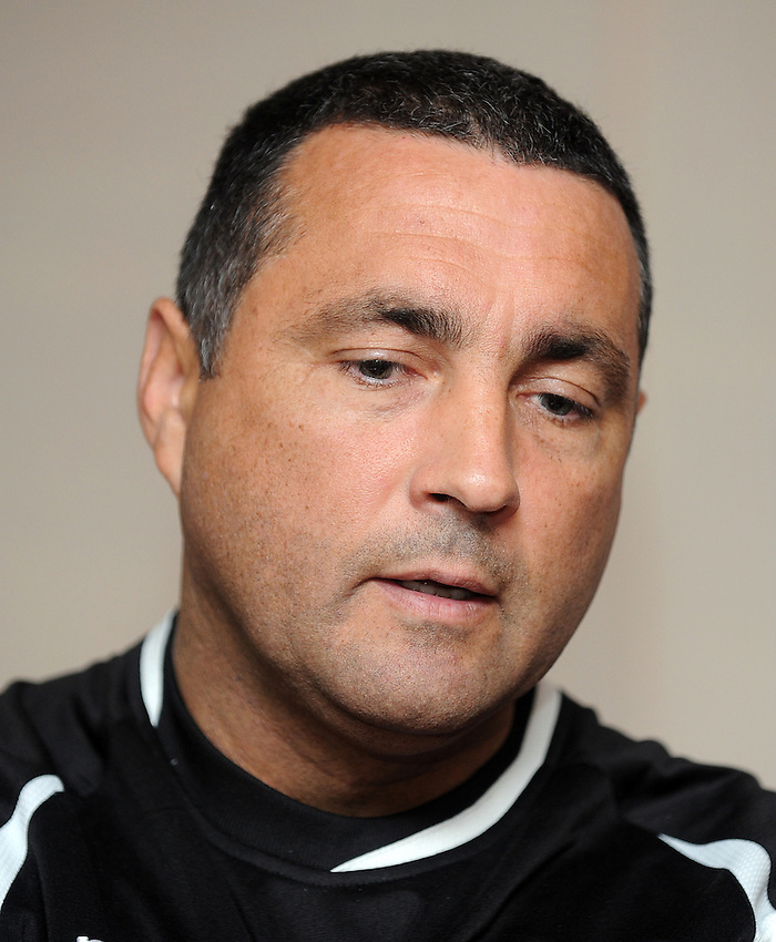 Edinburgh Rugby's Coach Michael Bradley speaks to journalists at the end of the game ..Rugby Union - RaboDirect PRO12 - Newport-Gwent Dragons v Edinburgh Rugby - Friday 28th September 2012 -  Rodney Parade - Newport....