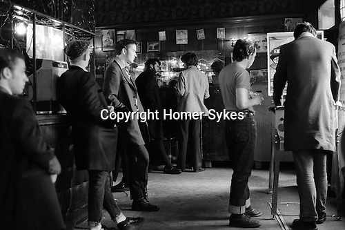 Teddy Boys wearing their distinctive drape jacket east London pub. Whitechapel London 1970s Britian...