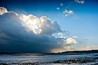 Friday 03 January 2014<br /> Pictured: The sun tries to break through the clouds after the storm at  Wisemans Bridge, Pembrokeshire<br /> Re: Storm force winds and some of the highest tides in decades hit Wales early on Friday.