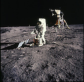 The Moon - (FILE) -- Apollo 11 astronaut Edwin Aldrin deploying the Early Apollo Science Experiments Package (EASEP) on Sunday, July 20, 1969. The package consists of a seismometer on the ground in front of Aldrin powered by a solar panel to the left. The white rod jutting out of the top of the instrument is the antenna to send the results back to Earth. Partially hidden behind Aldrin's right hand is the laser ranging retroreflector. .Credit: NASA via CNP