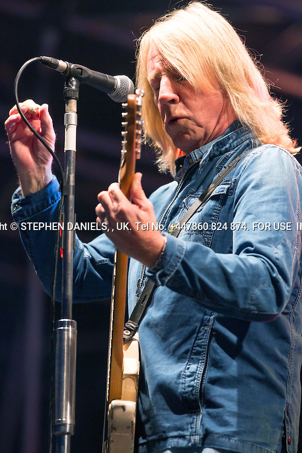 Status Quo Rick Parfit return on stage after his hart attack <br />  *NO INTERNET USE PERMITTED*  PRINT MEDIA ONLY<br /> &gt;<br /> DANPIC's; Photo by &copy; Stephen Daniels 23/08/2014 <br /> Rick Parfitt returns to the sage after his hart attack, play a concert - Holkham Hall, Norfolk with Status Quo.<br /> <br /> Minimum Fee &pound;200.00+vat<br /> &gt;<br /> All images supplied under the terms and condition of <br /> Stephen Daniels and not publication which use them.<br /> All images which is the copyright of Stephen Daniels<br /> and/or DANPICS are supplied under the terms and <br /> condition of Stephen Daniels<br /> &gt;<br /> Words by Medialincs Tel 07933 676119 Richard Vamplew