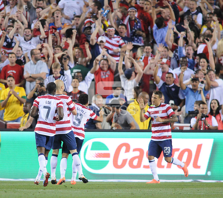 USMNT forward Hercules Gomez (9) celebrates with teammates after scoring against Brazil. The Brazil National Team defeated The USMNT 4-1 at FedexField, Wednesday May 30 , 2012.