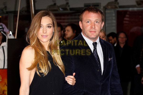 Jacqui Ainsley & Guy Ritchie.'African Cats' UK Premiere at BFI Southbank, London, England..25th April 2012.half length married husband wife black suit top.CAP/AH.©Adam Houghton/Capital Pictures.