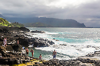 Queen's Bathtub, a seaside tidewater swimming hole on Hanalei Bay in the island of Kauai in Hawaii
