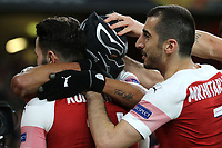 Arsenal players congratulate Pierre-Emerick Aubameyang wearing a mask, after scoring their third goal during Arsenal vs Rennes, UEFA Europa League Football at the Emirates Stadium on 14th March 2019