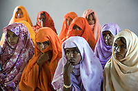 Eritrea. Anseba province. Hagaz. Behavioural Change Communication (BCC).  A group of black women, muslim and christians mixed together, wearing colorful veils on their heads to cover their hair, listen to a lecture on HIV Aids. The Global Fund through the eritrean Ministry of Health supports the programm with a Aids grant (financial aid). © 2006 Didier Ruef