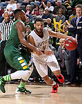 SIOUX FALLS, SD - MARCH 6:  Jordan Pickett #4 of IUPUI dribbles past Carlin Dupree #3 of North Dakota State in the 2016 Summit League Tournament. (Photo by Dave Eggen/Inertia)