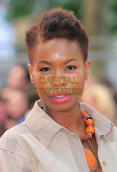 "TALLULAH ADEYEMI.attending the UK Premiere of ""Inglourious Basterds"" at the Odeon cinema, Leicester Square, London, England, UK, 23rd July 2009..portrait headshot pink lipstick orange wooden beads necklace .CAP/BEL.©Tom Belcher/Capital Pictures"