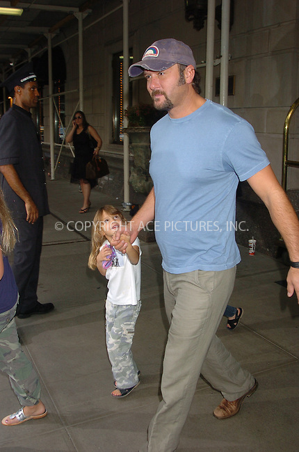 WWW.ACEPIXS.COM . . . . .  ....Tim McGraw with his wife Faith Hill and their daughters leave the Ritz Carlton.....Please byline: AJ Sokalner - ACEPIXS.COM..... *** ***..Ace Pictures, Inc:  ..(212) 243-8787 or (646) 769 0430..e-mail: info@acepixs.com..web: http://www.acepixs.com